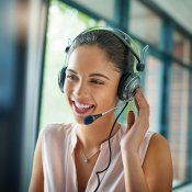 A woman using a headset to make a call